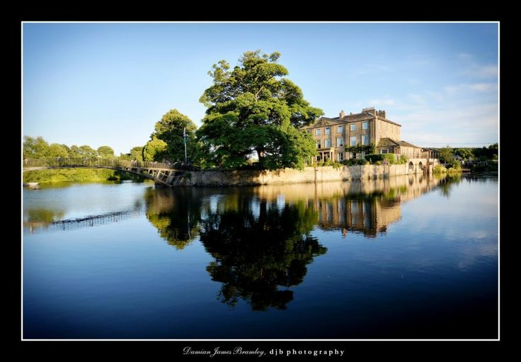 The magnificent Walton Hall, situated on an island surrounded by a 26 acre lake, only accessible by a picturesque wrought iron foot bridge