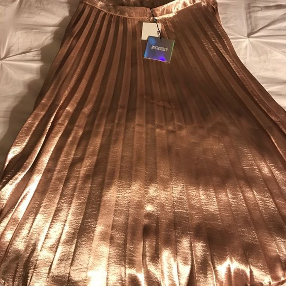 Shop Women's Missguided size 10 Midi at a discounted price at Poshmark. Description: MIDI skirt, pleated. Sold by __radha. Fast delivery, full service customer support.