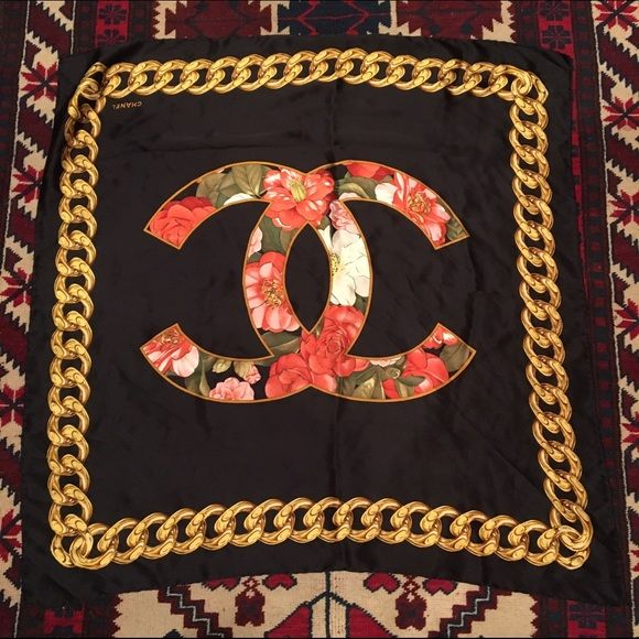 Beautiful Chanel Floral CC Scarf Such a beautiful Chanel scarf! Hand rolled silk edges!! With awesome chain design! Authentic! Chanel Accessories Scarves & Wraps