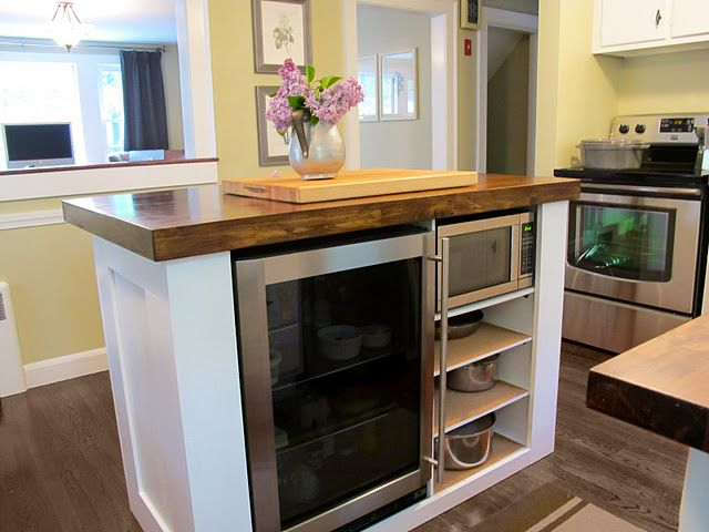 """Pretty and practical custom island (her husband """"whipped this up"""") ... my husband won't whip anything up like this, but I bet I could find someone who would! I love the wood counter and the space for a microwave!"""