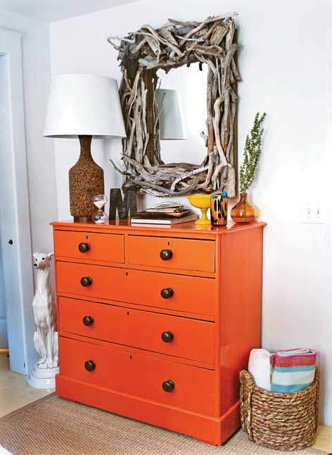 The orange dresser is cool, but I love the mirror and the basket of towels. Reminds me of Cape Cod and the beach.