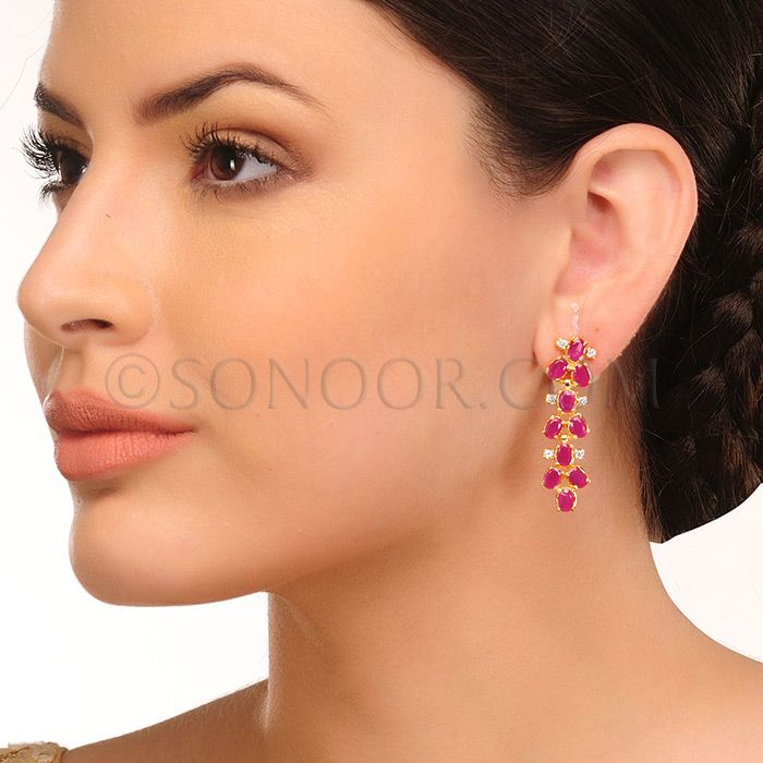 EAR/1/3441	 Earrings in silver rhodium finish studded with cubic zircons, ruby, and rhodonite 	$168	£99
