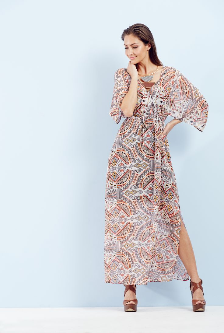 City Escape - The maxi dress with its simple directional shape, exclusive statement print and glamorous side split delivers easy on-trend style.