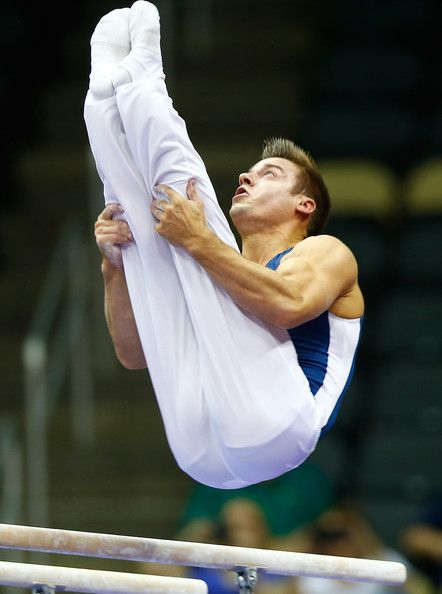 Sam Mikulak Photos Photos - Sam Mikulak competes on the parallel bars in the senior men finals during the 2014 P&G Gymnastics Championships at Consol Energy Center on August 24, 2014 in Pittsburgh, Pennsylvania. - P&G Gymnastics Championships