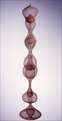 """Ruth Asawa, Untitled, S065, early 1960s. Hanging seven lobed continuous multi-layered form within a form. Crocheted copper and brass wire (17"""" diameter x  94"""" high)."""
