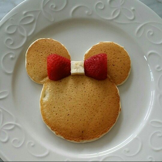Minnie mouse pancakes with a strawberry and banana