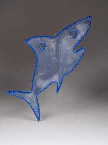 Scary blue shark reflector. Comes with a blue ball chain.  Attach to bags, jackets or any other garments or equipment.  Approximately 85mm high and 40mm wide.  For maximum visibility place on the front, side or back of your body. Allow your reflector to move freely at knee length to catch the headlights of moving vehicles.