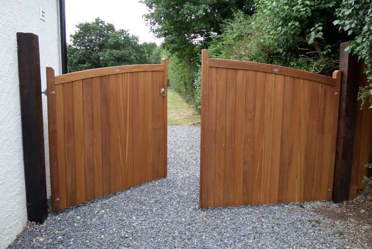 """Hardwood driveway gate. The Chappelwood design constructed using the finest, hand selected iroko timber. Sweeping header that truly """"makes an entrance""""."""