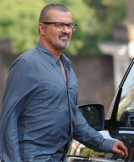 LONDON, UNITED KINGDOM - AUGUST 25: George Michael leaves the Cote Brassiere restaurant in Highgate on August 25, 2013 in London, United Kingdom. (Photo by ANT/Bauer-Griffin/GC Images)