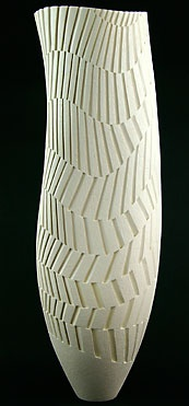 Ashraf Hanna, love the sinuous flow through the form and the way it translates into the geometric surface carving. Sublime.