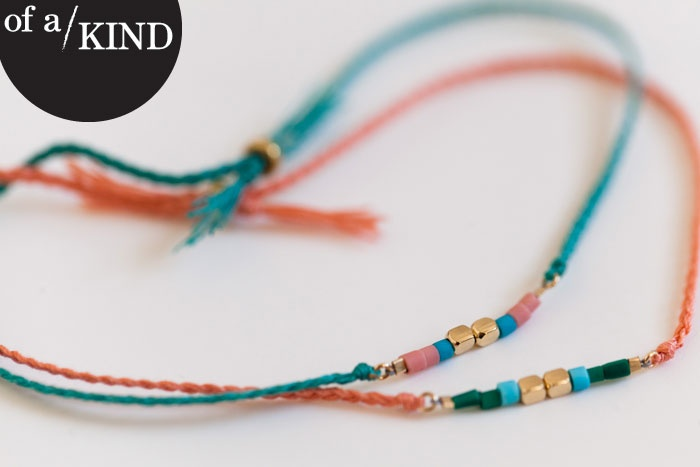 PIN TO WIN! Of a Kind is so in love with these limited-edition ORA bracelets and Pinterest that we're combining our obsessions: Pin this pic for a chance to score a set of these silk-and-gold babies. Winner chosen on 7/26!