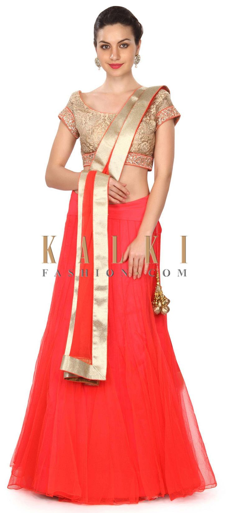 Buy this Coral lehenga matched with embroidered blouse only on Kalki