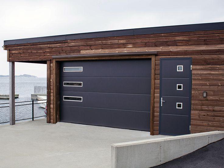 Sektionaltor mit Nebentür. Passend aufeinander abgestimmtes Tor mit Nebentür. Die Glaseinsätze bieten zudem reichlich Licht in der Garage.