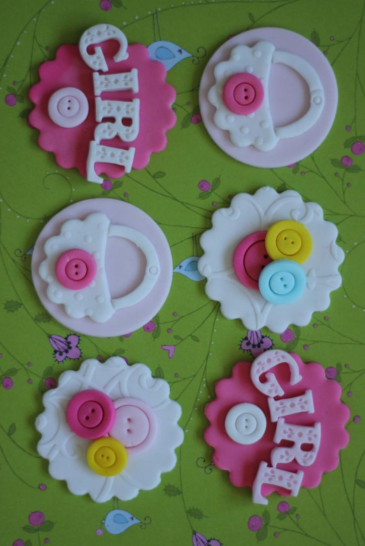 Baby shower fondant toppers.  Available at https://www.etsy.com/shop/LesPopSweets?ref=hdr_shop_menu