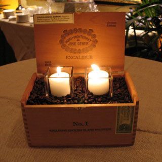 High-top cocktail tables were draped in chocolate and burlap linens with coffee bean-filled cigar box centerpieces.