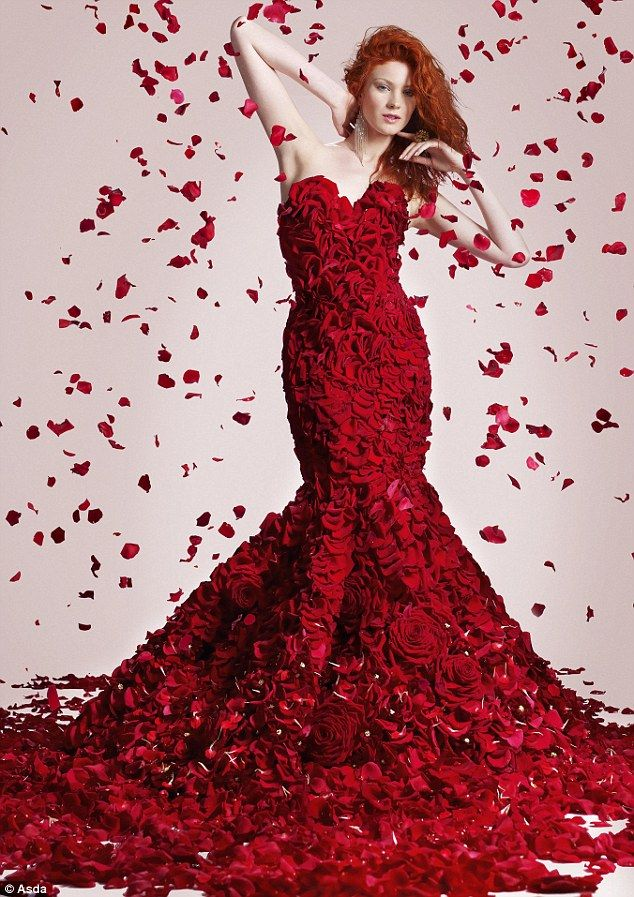 Flower Dress   Stats:   - Weighs 27 lbs  - Took 170 hours to make   - Made from 1,725 flowers   - Petals from 1,000 Naomi red roses cover the entire body  - 15 Carmen roses, 200 chrysanthemums on the hip and skirt  - Petals from 150 Purple Power Roses, 75 gerberas and 300 carnations used on the hem  - Completed with a pair of rose covered stiletto heels.    Talk about a serious Valentines dress!