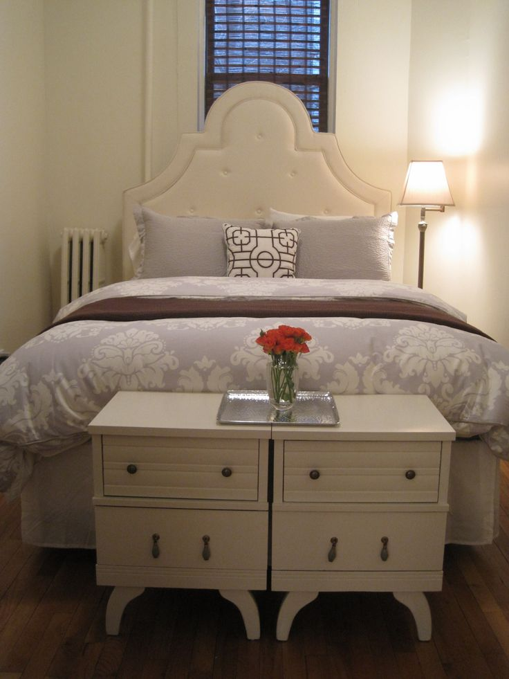 Small bedroom space idea ~ Wow, I never thought of putting the bedside tables together at the end of the bed!