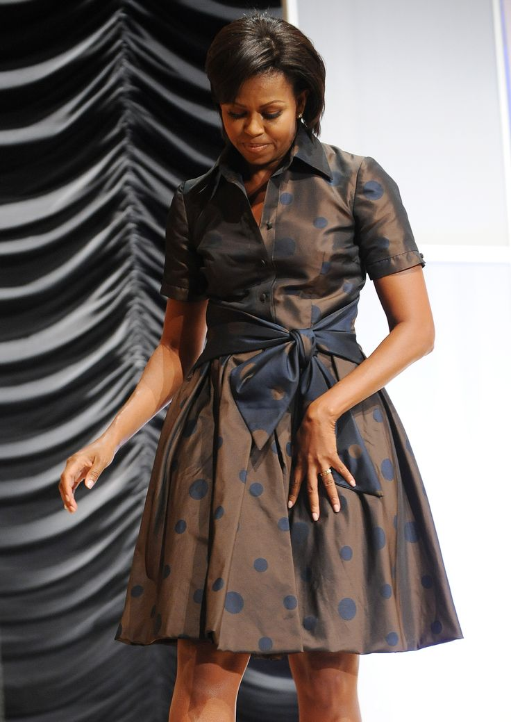 US First Lady Michelle Obama leaves after delivering remarks on the