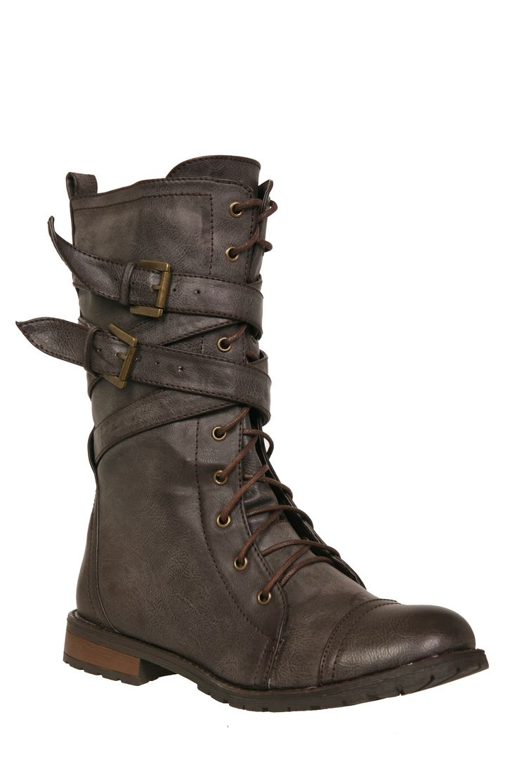 These brown boots feature crisscrossed straps.