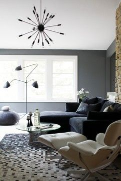 A sputnik light pendant grounds this gray modern living room.