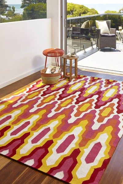 Amalfi, Sunrise A vibrant red, orange, pink, yellow and natural white design flatweave NZ wool rug.  Available to see in store now and available to order in the following sizes:  160 x 230, 200 x 290, 250 x 350