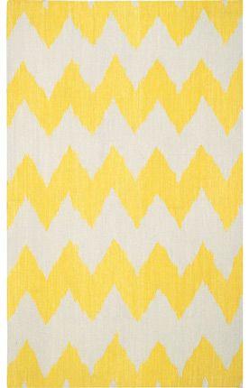Yellow chevron rug.