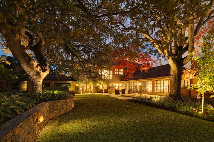 Uplighting on feature trees + stone wall. Armadale, VIC Australia. Anthony Wyer + Associates www.anthonywyer.com