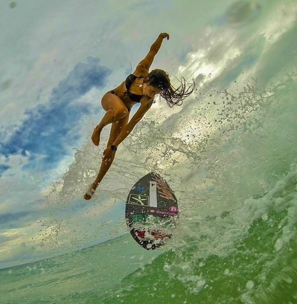 Looks like skimboarding- tried it once, my wipeout didn't make it off the sand