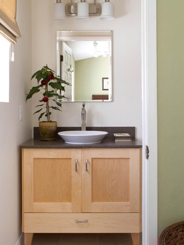 This fully remodeled master bathroom features a custom for Master bathroom vessel sink