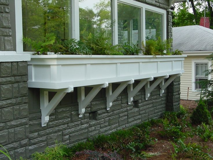 Extra large window box designed by Heather Moll-Dunn Landscape and Garden Design gives a flat facade more dimension and makes the house one of a kind.