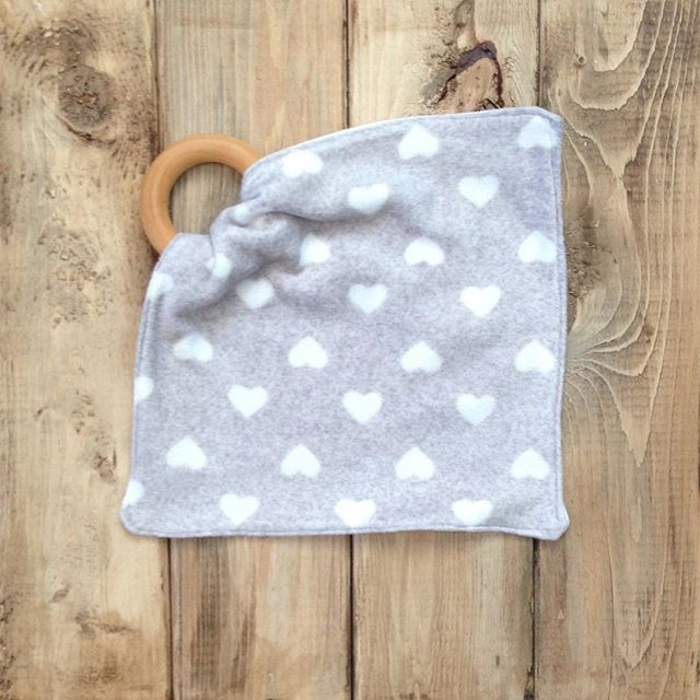 A teething baby is no joke! Our teething blankets help soothe the pain for little and mama ;) #etsyshop #shopetsy #shophandmade #handmade #shoplocal #shopsmall #supporthandmade #teethingbaby #teethingring #organicteethingring #valentinesgift #valentinesday #teethingblanket #sensorytoy #sensoryblanket #teether #heartteether #babygirl #teething #canadianmade #canadianbaby #babyboutique #afterthestork