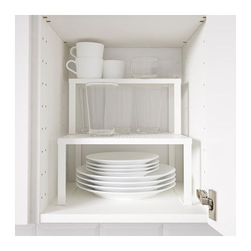 VARIERA Shelf insert IKEA Place on a shelf to get more storage space for glasses, bowls and spice jars.