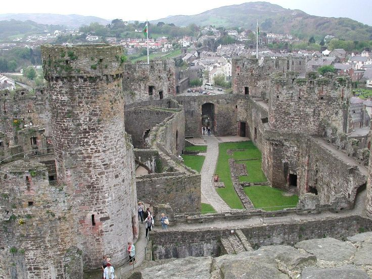 """Conwy Castle- magnificent castle construction began in 1283. The castle was an important part of King Edward I's plan of surrounding Wales in """"an iron ring of castles"""" to subdue the rebellious population. The highly defensible wall Edward built around the town was intended to protect the English colony planted at Conwy. The native Welsh population were violently opposed to English occupation of their homeland."""