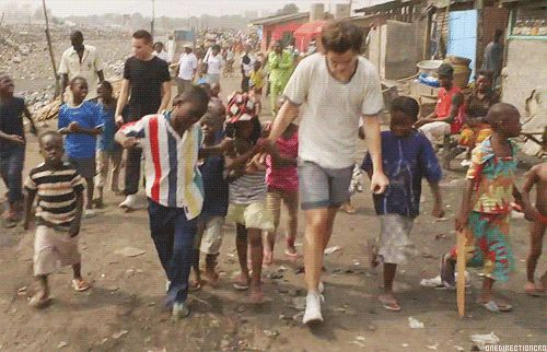 Pin for Later: If You're Not Obsessed With Harry Styles For Some Reason, Allow Us to Help This Too-Sweet Moment in Ghana