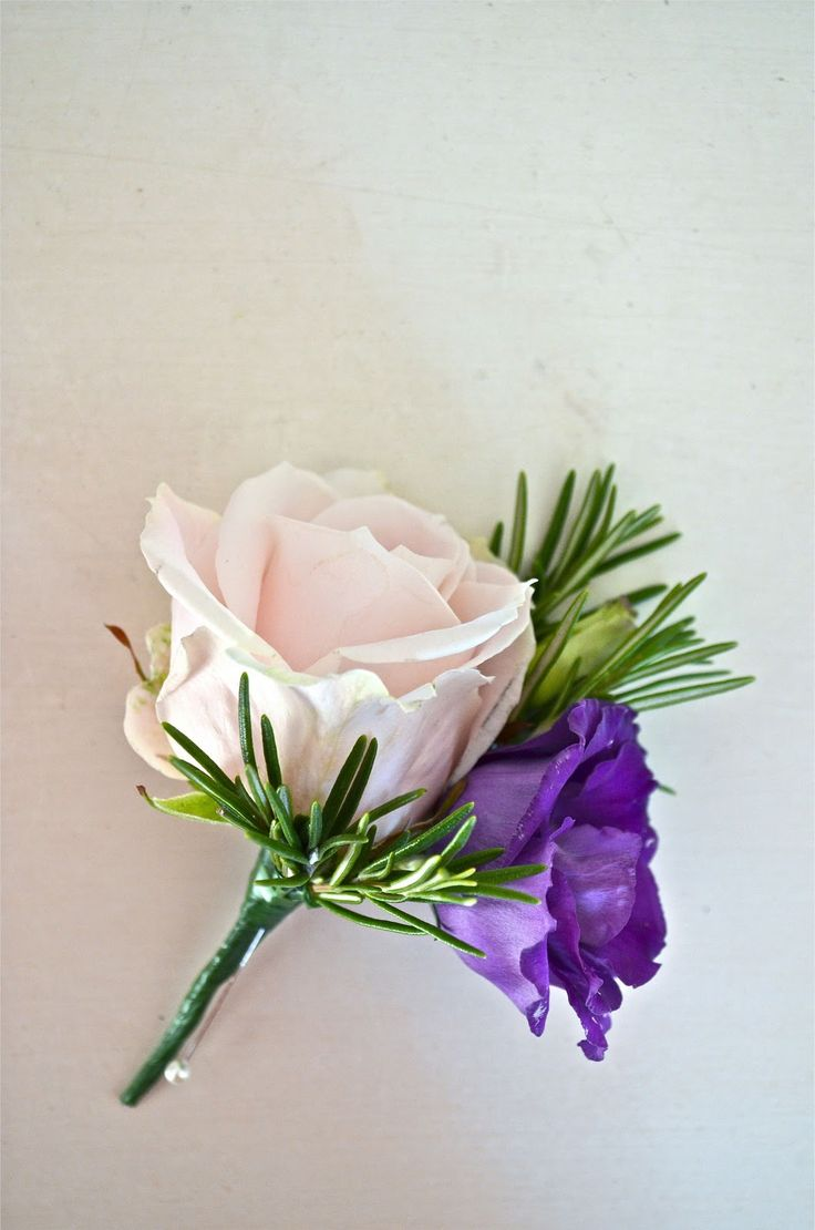 Groom's buttonhole of pink rose, purple lisianthus and rosemary