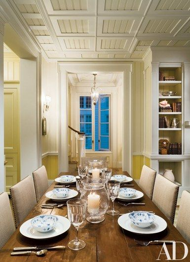 In the dining room, painted coffered ceilings, wainscoting and built-in shelves reflect the emphasis on detailing throughout. Lee Jofa table   archdigest.com   www.bocadolobo.com #bocadolobo #luxuryfurniture #exclusivedesign #interiodesign #designideas #dining #diningtable #luxuryfurniture #diningroom #interiordesign #table #moderndiningtable #diningtableideas #moderndiningroom #diningspace #diningarea #diningchair #diningset #diningroomset #tablesetting #diningdesign