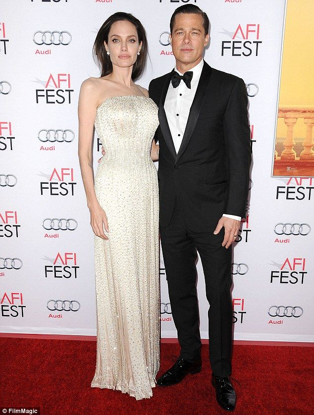 Happy couple: Angelina and Brad are pictured here at the premiere of By The Sea in November
