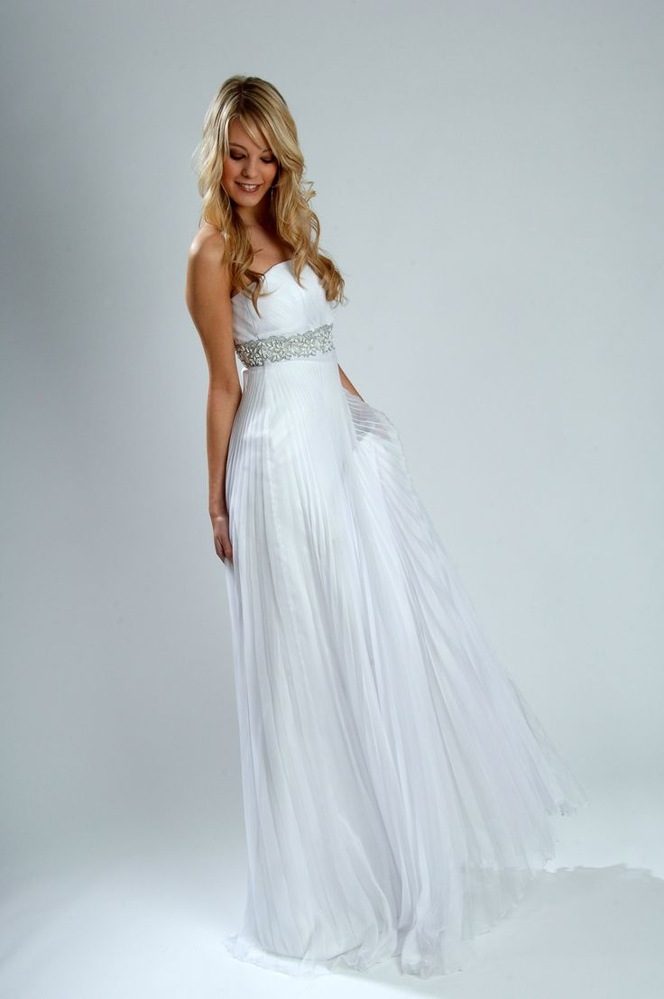 A pleated skirt and intricate beading at the waistline - this gorgeous gown is for SALE!