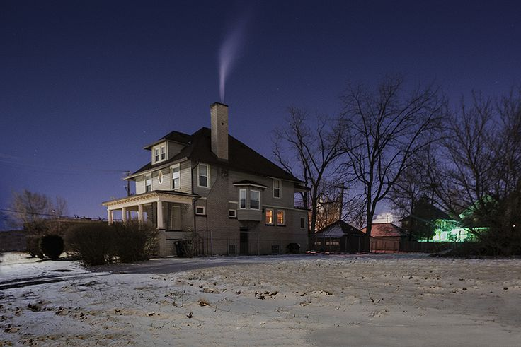 Detroit: Where We Used to Live - photographs by Bill Schwab  juxtaposition between quiet and empty and the light in the windows and smoke which connotes life inside