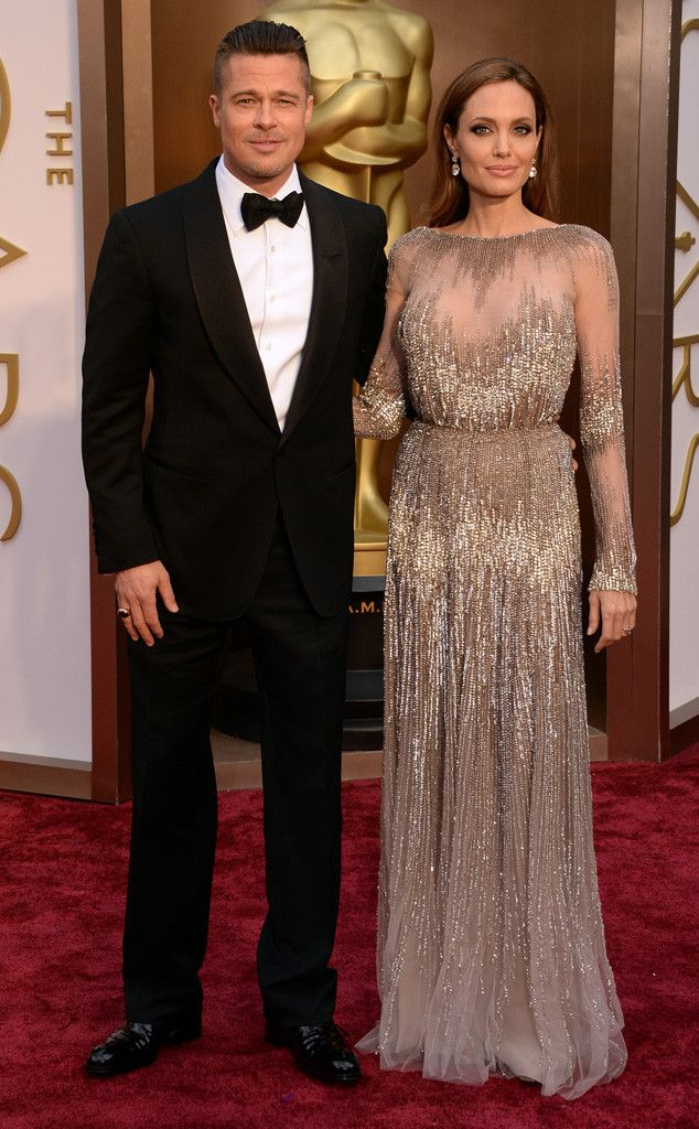 Angelina Jolie and Brad Pitt look every bit the Hollywood power couple on the Oscars red carpet!