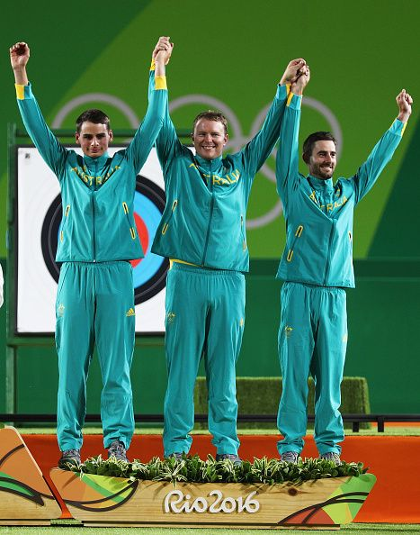 #RIO2016 - Best of Day 1 - Alec Potts Ryan Tyack and Taylor Worth of Australia celebrate with their Bronze Medals after finishing third during the Men's Team Final match on Day...