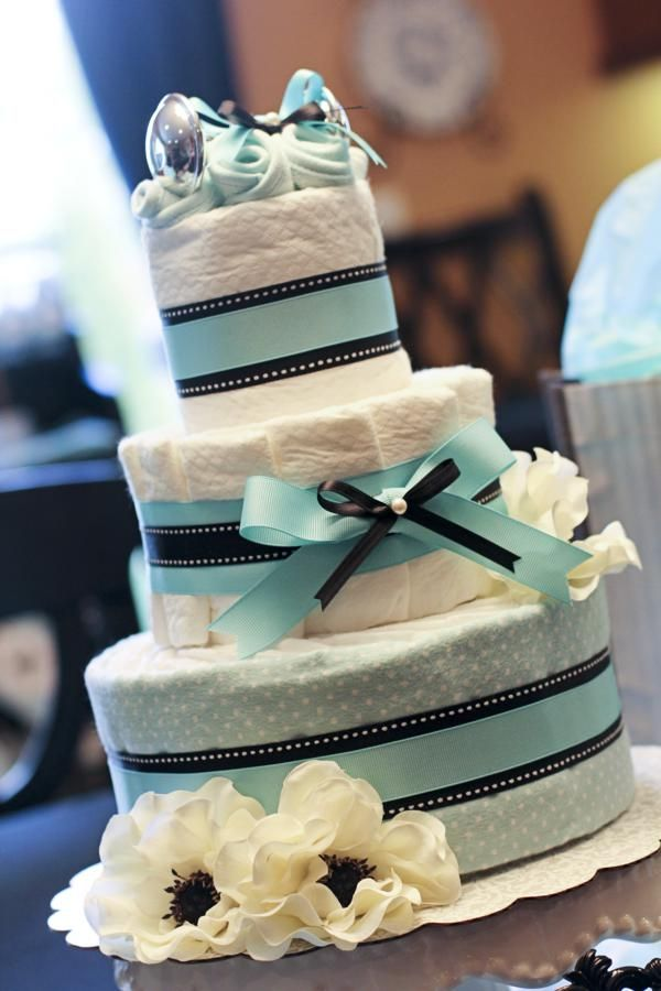 Fun diaper cake idea for a baby shower! Via Kara's Party Ideas @HUGGIES Baby Shower Planner