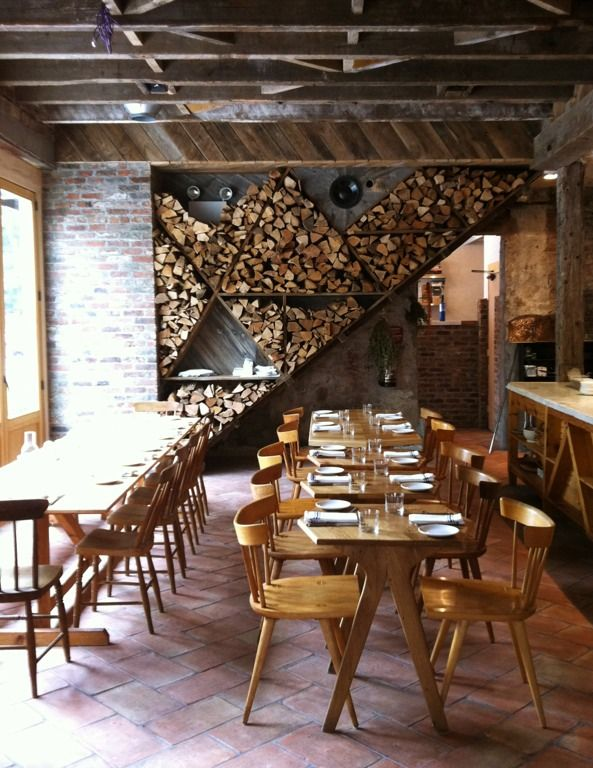 Isa in Williamsburg - photo by Leslie Williamson. Love the Nakashima Straight Back chairs. True vintage.