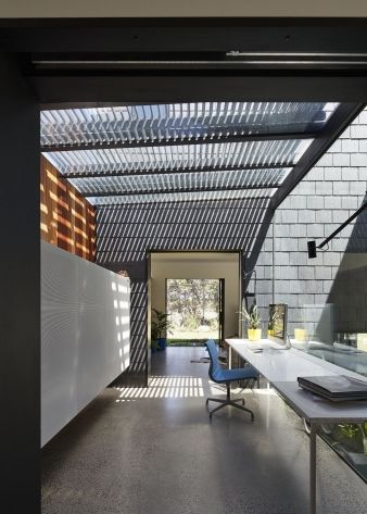Slats prevent natural light from flooding this home office