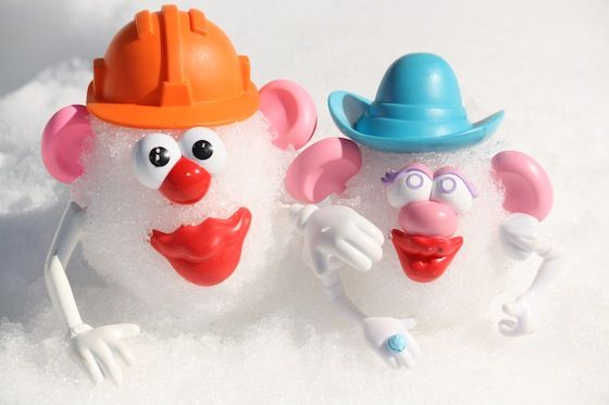 Potato Heads in the snow are great fun for a winter activity. Take your potato heads outside, or bring a bin of snow inside for snowy, potato head fun.