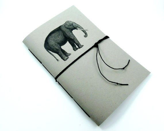 Cute elephant notebook with a medium gray cover. Makes a wonderful gift for elephant lovers! Journal measures 5-1/2 wide by 8-1/2 long and is a great size to keep in a bag or backpack. Includes 50 sheets/100 sides of 24 lb. white paper. Choose from lined/ruled, dot grid, blank, checkbox, eight stave music or 1/4 graph paper pages.  Cover is made of card stock which has been adhered to flexible but sturdy chipboard. Handbound in a pamphlet stitch with black hemp twine....