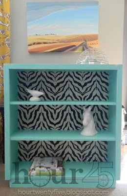 hour25 ~ Turquoise bookcase with zebra print wallpaper ~ SO fun!