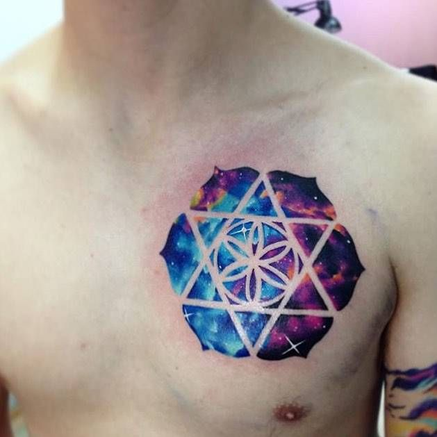 Chilean tattoo artist Adrian Bascur creates watercolor tattoos in which he blends animal silhouettes and geometric shapes with the vibrant colors of Space. Tattoo Motive, I Tattoo, Watercolor Galaxy Tattoo, Aquarell Tattoos, Triangle Tattoos, Animal Silhouette, Deathly Hallows Tattoo, Beautiful Tattoos, Geometric Shapes