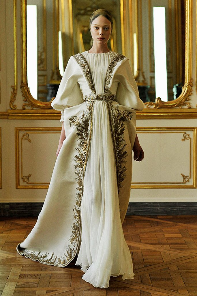 V-neck Houppelande of the Late Middle Ages, its fitted throughout the bodice then fulling out above the waist, deep-v neckline with fabric in between and belt under the bust  Fall 2010 Ready-to-Wear - Alexander McQueen