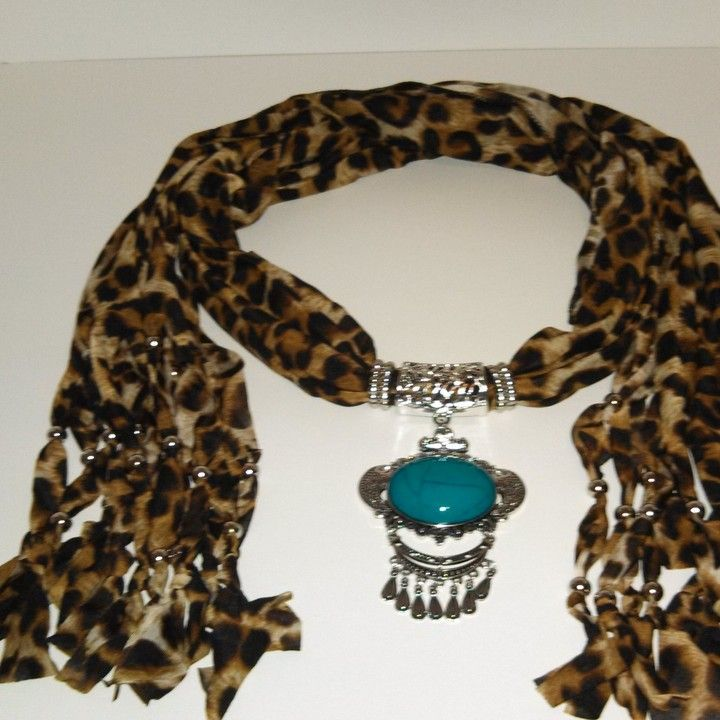 Dark Leopard print w/ turquoise medalion Scarf from Country Casual Clothing Company for $12.99 on Square Market